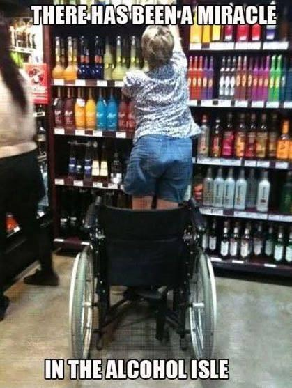 woman standing out of her wheelchair to reach for bottle of liquor, with the caption there has been a miracle in the alcohol isle